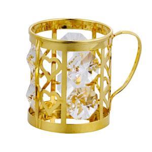 Эта маленькая (4 на 5 см) покрытая золотом и инкрустированная 6 кристаллами Сваровски пивная кружка для пива вовсе не предназначена. Украшение ручной работы стоит около 100$.