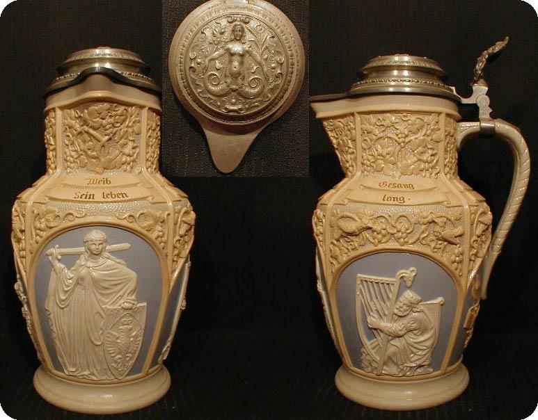 Поллитровая коллекционная пивная кружка с декоративной крышкой. Старинная, произведена около 1887 года. Стоит около 10 000 рублей.